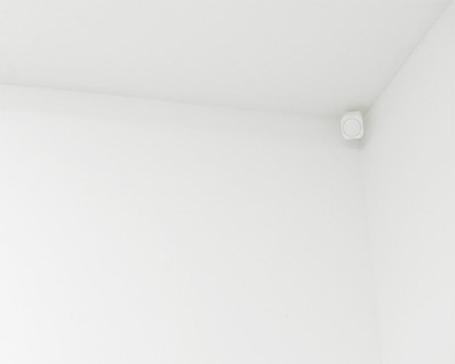 Room Sensor positioned in corner of ceiling